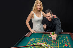 Couple playing roulette wins at the casino. Stock Photography
