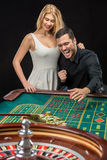 Couple playing roulette wins at the casino. Royalty Free Stock Photo