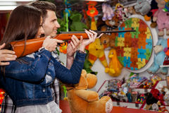 Couple playing shooting games Royalty Free Stock Photos