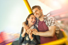 Couple playing shooting games while visiting an amusement park. Young men holding gun and shooting royalty free stock photo