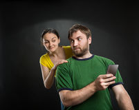 Couple playing with smartphone Stock Photo