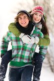Couple playing in snow Royalty Free Stock Images