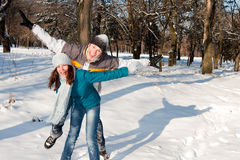 Couple playing in snow Stock Image