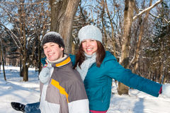 Couple playing in snow Royalty Free Stock Photo