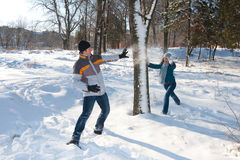 Couple playing with snow Stock Photos