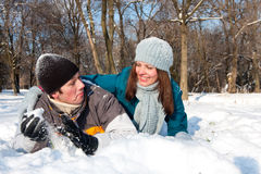 Couple playing in snow Stock Photo