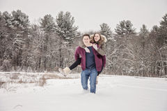 Couple playing in snow Royalty Free Stock Image