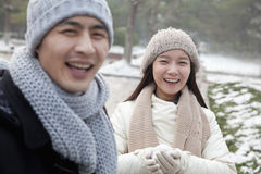 Couple Playing in the Snow, Laughing Royalty Free Stock Photography