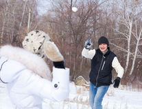 Couple playing snowball Stock Photos