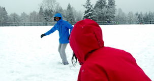 Couple playing with snowball. During winter stock video footage