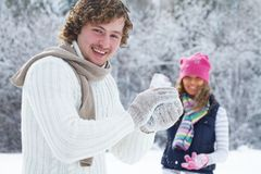 Couple playing snowballs Royalty Free Stock Photo