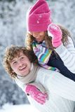Couple playing snowballs Stock Image