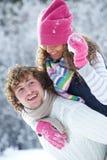 Couple playing snowballs Stock Image