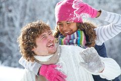 Couple playing snowballs Stock Photo