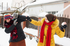 Couple playing snowballs stock photography