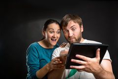 Couple playing with tablet Royalty Free Stock Photography