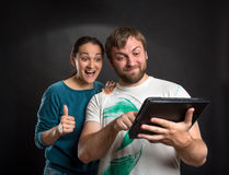 Couple playing with tablet Royalty Free Stock Images