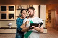 Couple playing with tablet royalty free stock image
