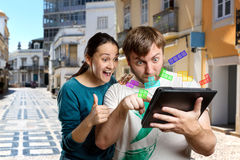 Couple playing with tablet stock images