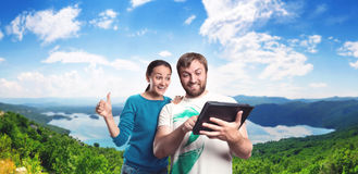 Couple playing with tablet on the street Stock Image