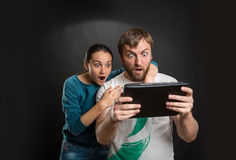 Couple playing with tablet on the street Royalty Free Stock Photography
