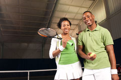 Couple playing tennis Stock Photos