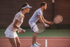 Couple playing tennis Stock Images