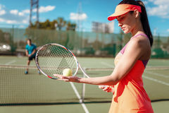 Couple playing tennis on outdoor court. Summer season active sport game Royalty Free Stock Image