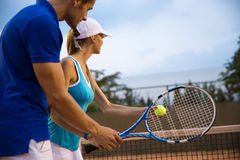 Couple playing in tennis Stock Photography