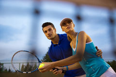 Couple playing in tennis Royalty Free Stock Photos