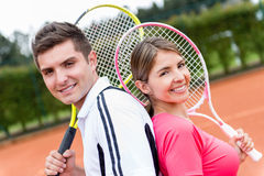 Couple playing tennis Royalty Free Stock Image