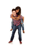 Couple playing together piggyback Stock Images