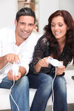 Couple playing a video game Stock Images
