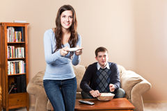 Couple playing video games. A shot of a young couple playing video games Royalty Free Stock Image