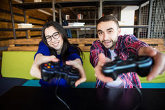 Couple playing video games. Cute couple playing video games Stock Photography