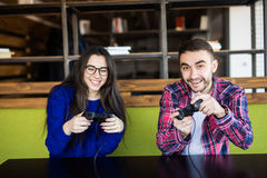 Couple playing video games. Cute couple playing video games Stock Images