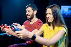 Couple playing video games with gaming console in the club royalty free stock photos