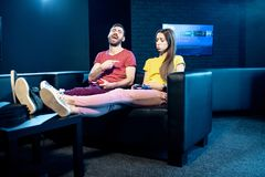 Couple playing video games with gaming console in the club royalty free stock photo
