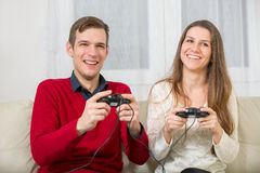Couple playing video games Stock Photos
