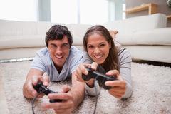 Couple playing video games in the living room Royalty Free Stock Photo