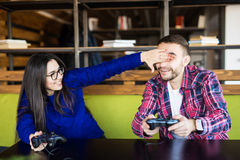 Couple playing video games. Couple play video games. Girl close men eyes Royalty Free Stock Photo