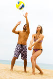 Couple playing volleyball Stock Photos
