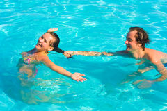 Couple playing in the water Royalty Free Stock Image