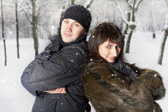 Couple playing in winter park Royalty Free Stock Images