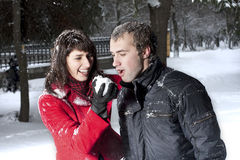 Couple playing in winter park Stock Photo
