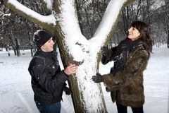 Couple playing in winter park Stock Image
