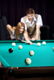 The couple plays billiards royalty free stock images