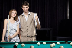 The couple plays billiards stock photo