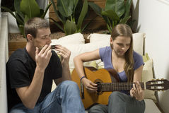 Couple Plays Music Together - Horizontal Stock Image