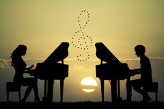 Couple plays the piano at sunset. Illustration of a couple plays the piano at sunset Royalty Free Stock Images